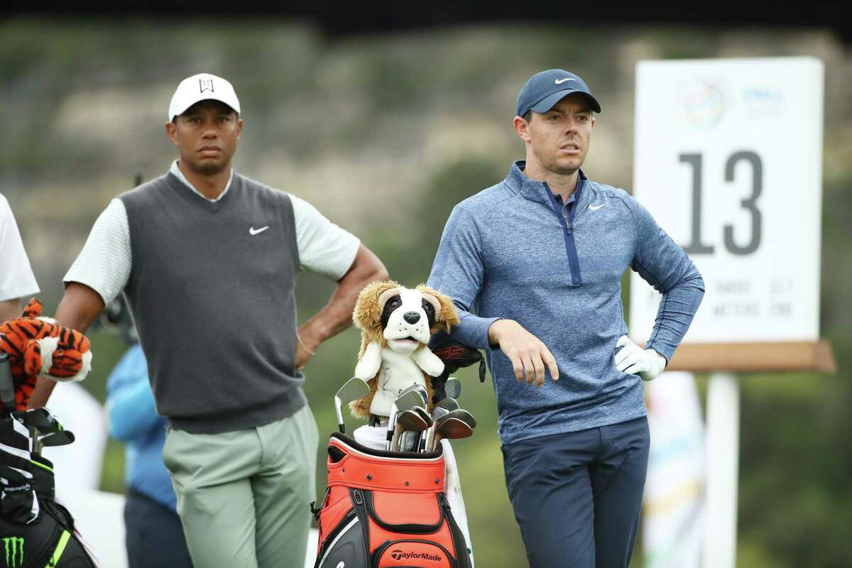 AUSTIN, TEXAS - MARCH 30: Tiger Woods of the United States and Rory McIlroy of Northern Ireland stand on the 13th tee during the fourth round of the World Golf Championships-Dell Technologies Match Play at Austin Country Club on March 30, 2019 in Austin, Texas.