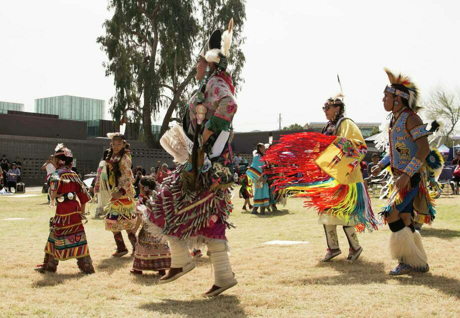 Dancers perform during Arizona's first Two-Spirit Powwow on March 9 in Phoenix. Most powwows have separate competition categories for male and female dancers, but this powwow did away with gendered categories and opened competitions to all. Photo: Photo By Katherine Davis-Young For The Washington Post / For The Washington Post