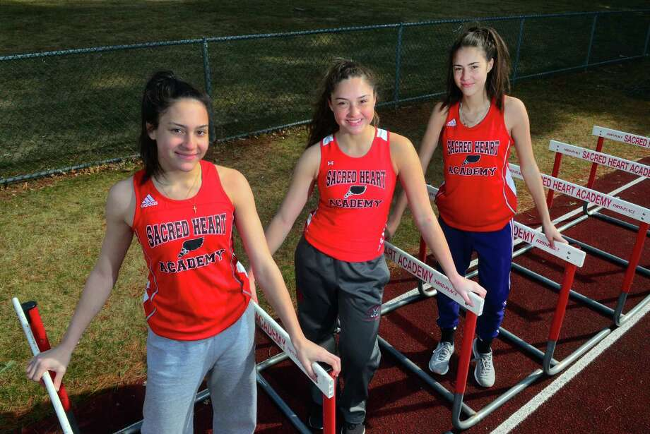 Sisters Aliya Cameron, Kayla Cameron and Meaghan Cameron pose at Sacred Heart Academy in Hamden, Conn., on Wednesday, Mar. 27, 2019. All three are on the girls outdoor track team. Each girl has their expertise - Aliya does the triple jump, Kayla does the pole vault and 100 hurdles and Meaghan excels in the 400. Photo: Christian Abraham / Hearst Connecticut Media / Connecticut Post