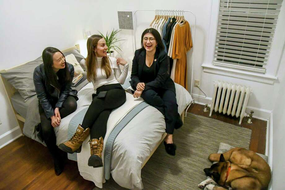 Assemblywoman Yuh-Line Niou, left, and two newly elected state senators, Alessandra Biaggi, center, and Jessica Ramos, in their shared apartment in Albany, N.Y., March 5, 2019. The trio of new roommates, all of whom took over seats held by powerful men, reflect a younger, more female Albany. Photo: CINDY SCHULTZ, New York Times / NYTNS