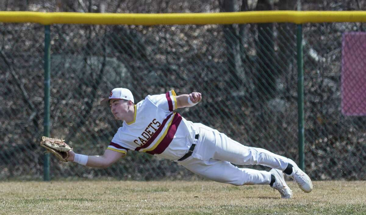 St. Joseph High centerfielder Al Paolozzi dives to catch a fly ball during a game against Bethel on Saturday in Trumbull.