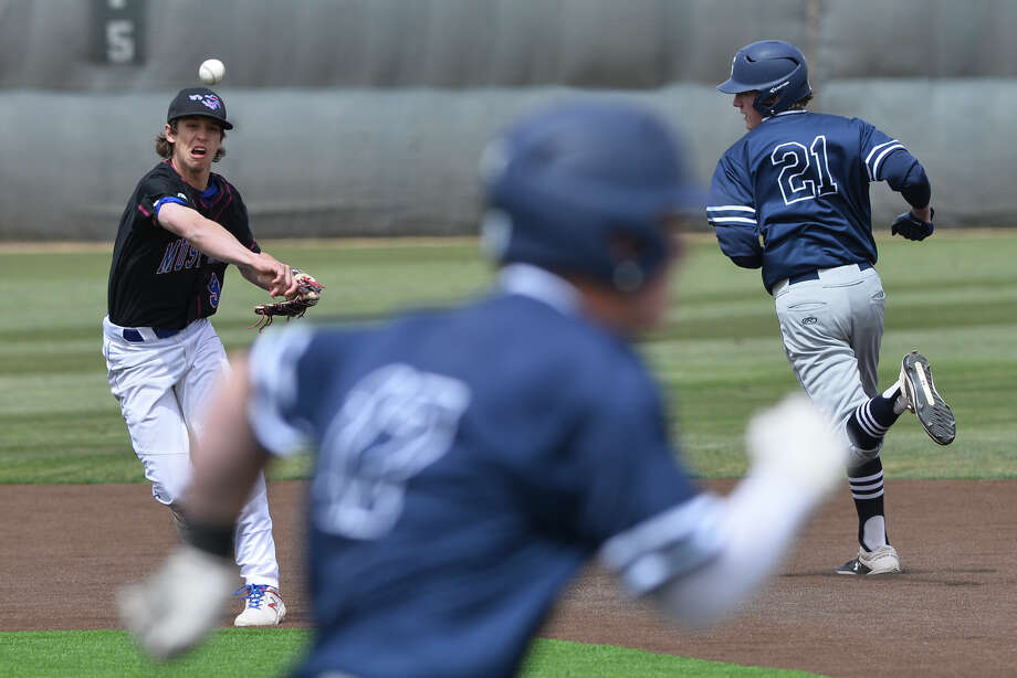 Midland Christian's Gage Jordan throws to first base after getting an out at second against Fort Worth All Saints' Jack Hardgrove (21) March 30, 2019, at Christensen Stadium. James Durbin / Reporter-Telegram Photo: James Durbin / Midland Reporter-Telegram / ? 2019 All Rights Reserved