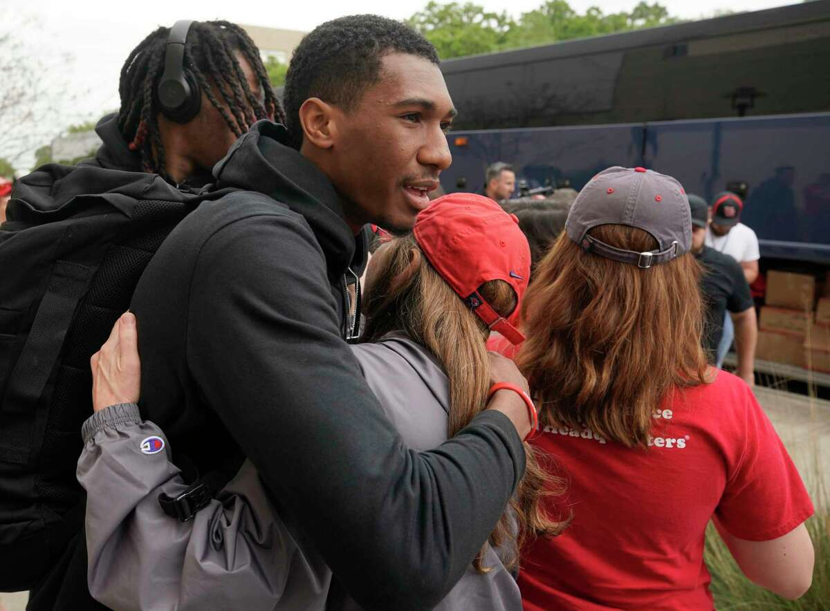 Player Armoni Brooks hugs a fans during a welcome event as the University of Houston men's basketball team returns to the campus Saturday, March 30, 2019, in Houston. The team lost 62-58 to Kentucky in the NCAA Midwest Regional in Kansas City on Friday.