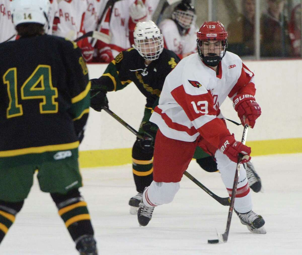 Greenwich's Ryan Columbo (13) controls the puck in Greenwich's 7-0 win over Trinity Catholic in the high school boys ice hockey game at Dorothy Hamill Rink in Greenwich, Conn. Monday, Jan. 28, 2019.