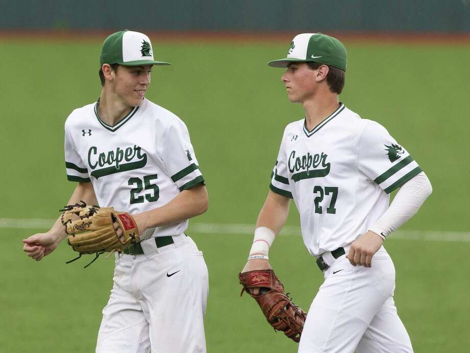 John Cooper's Jacob Redbrook (25) and Evan Godwin (27) trot off the field during a game in March. Both contributed to a 10-0 win over The Woodlands Christian Academy Thursday night. Photo: Jason Fochtman, Houston Chronicle / Staff Photographer / © 2019 Houston Chronicle
