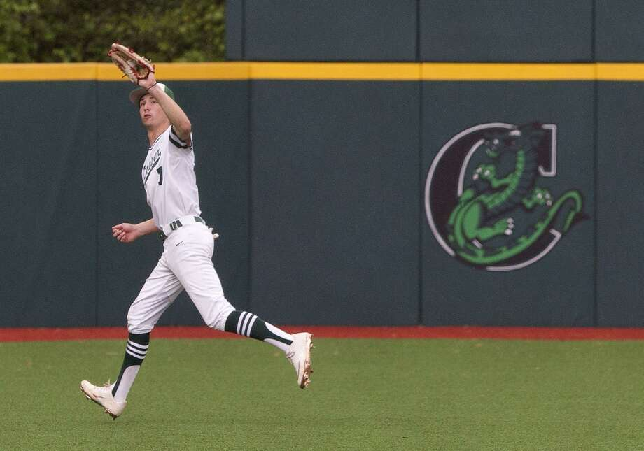 In this file photo, John Cooper center fielder Logan Leax (7) catches a fly ball on the run during the sixth inning of a non conference game at The John Cooper School, Saturday, March 30, 2019, in The Woodlands. Photo: Jason Fochtman, Houston Chronicle / Staff Photographer / © 2019 Houston Chronicle