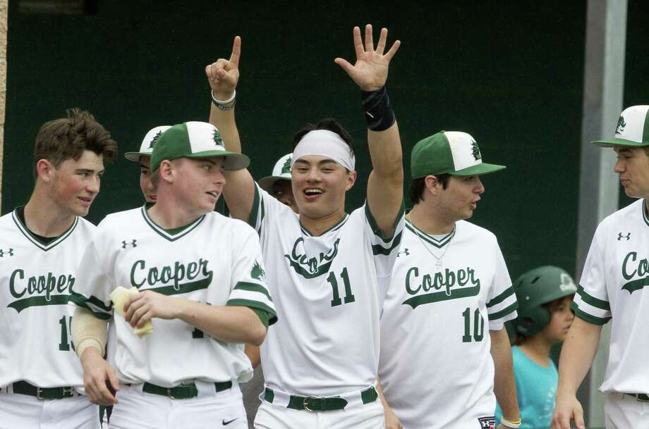 Jonathan Spangler-Sakata #11 of John Cooper holds up six with his hands after Logan Leax hit his sixth home run of the season during the fourth inning of a non conference game at The John Cooper School, Saturday, March 30, 2019, in The Woodlands. Photo: Jason Fochtman, Houston Chronicle / Staff Photographer / © 2019 Houston Chronicle