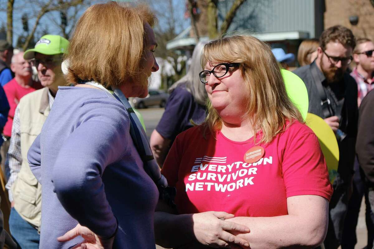 Seattle Mayor Jenny Durkan speaks with Jewish Federation shooting survivor Cheryl Stumbo as several dozen people attend a community gathering at Lake City Mini Park to support each other, talk and demonstrate strength after Wednesday's violent carjacking which took the lives to two Lake City residents, Saturday, March 30, 2019.