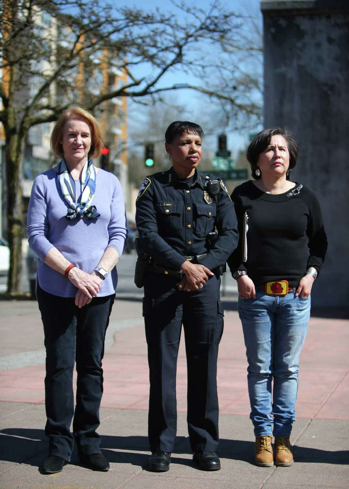 Seattle Mayor Jenny Durkan, left, Police Chief Carmen Best and 5th district city councilwoman Debora Juarez stand together as several dozen people attend a community gathering at Lake City Mini Park to support each other, talk and demonstrate strength after Wednesday's violent carjacking which took the lives to two Lake City residents, Saturday, March 30, 2019.