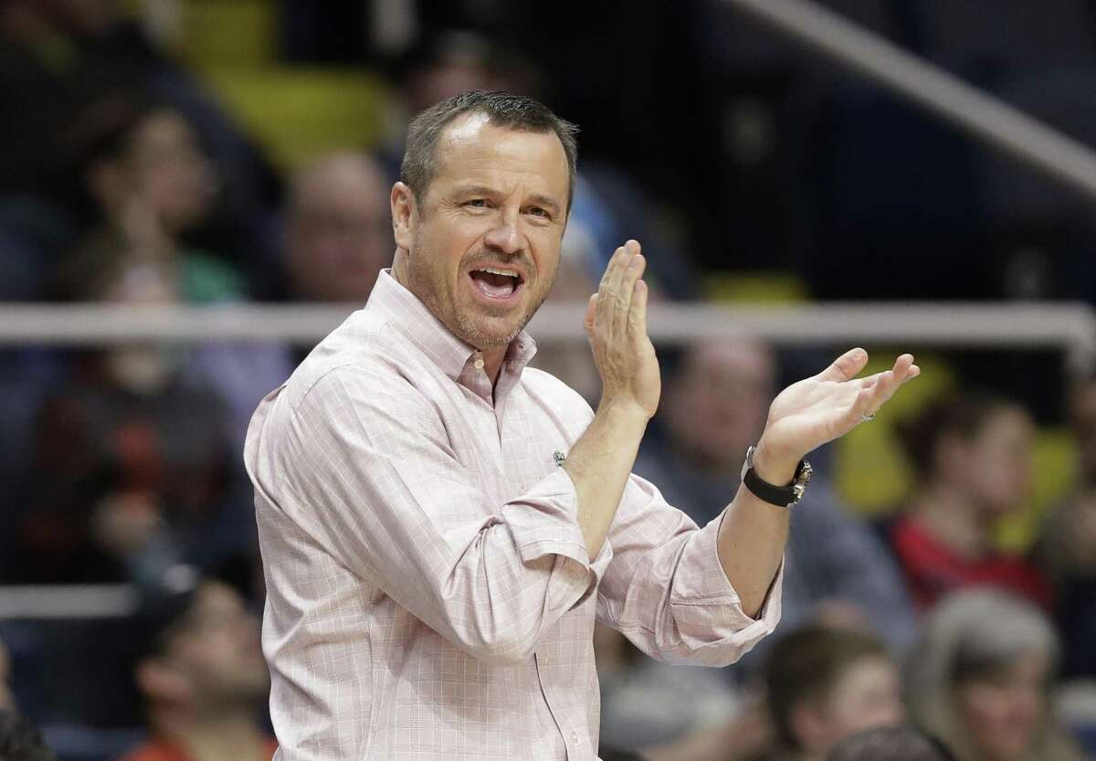 Louisville coach Jeff Walz applauds his team during Friday's regional semifinal against Oregon State.
