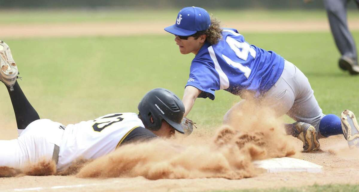 Bears baserunner Xavior Salazar slides safely into third to beat the tag of Mustang's third baseman Raymond Luna in the fifth inning as Brennan beats Jay 10-0 in District 28-6A baseball at Northside Field 1 on March 30, 2019. Salazar was able to score from third in the inning.