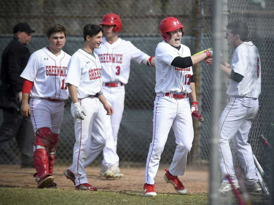 Greenwich's Jackson Blanchard (17), second from right, celebrates scoring against Simsbury on Saturday. Photo: Matthew Brown / Hearst Connecticut Media / Stamford Advocate