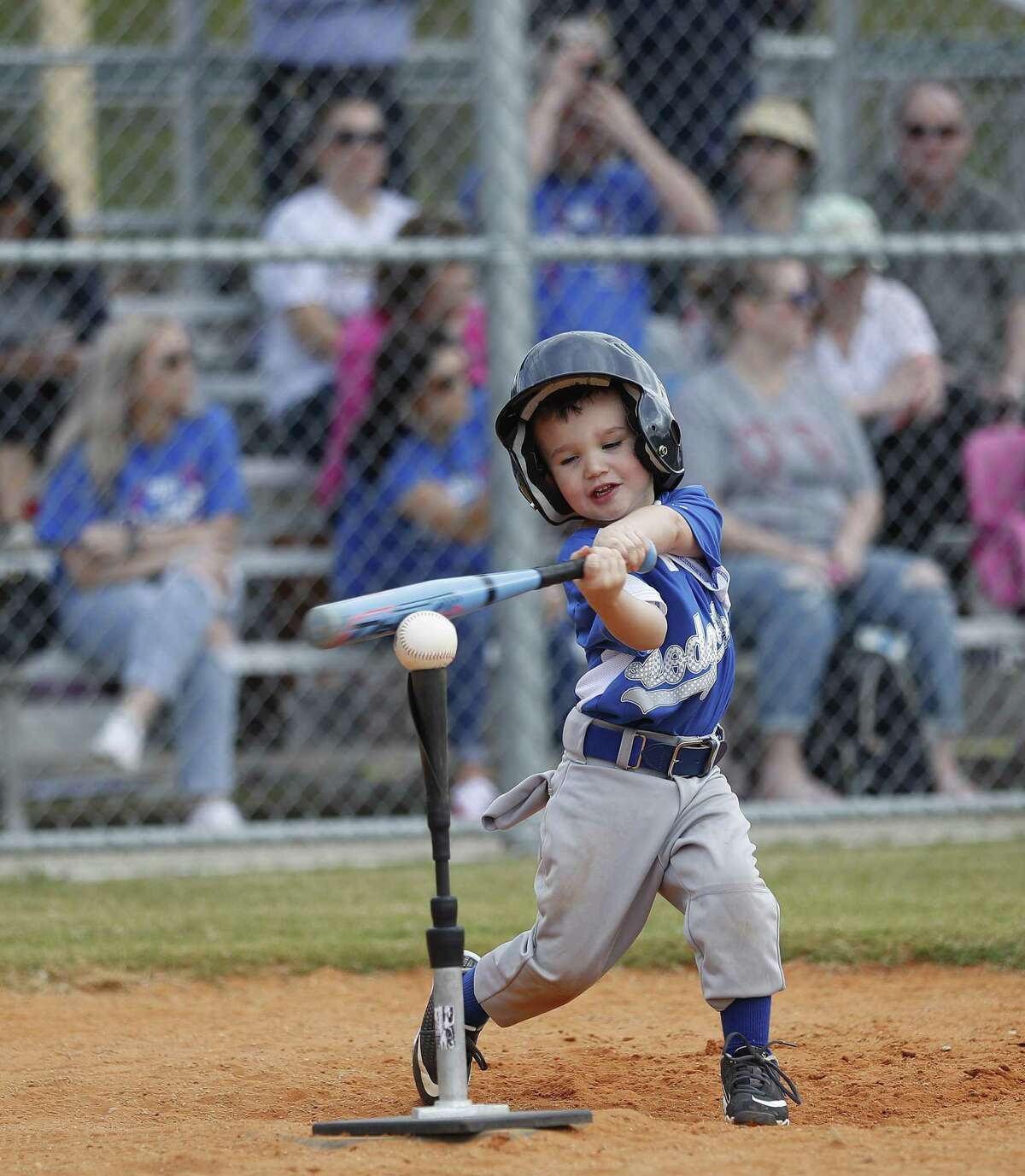 Eli Crull, 4, hits the ball off the tee during Deer Park PONY baseball games at Spencerview Athletic Complex, Saturday, March 30, 2019, in Deer Park. First the Deer Park PONY baseball league had to cancel games because of bad weather. Then came the ITC chemical fire, which cancelled another full week of games and Opening Day.