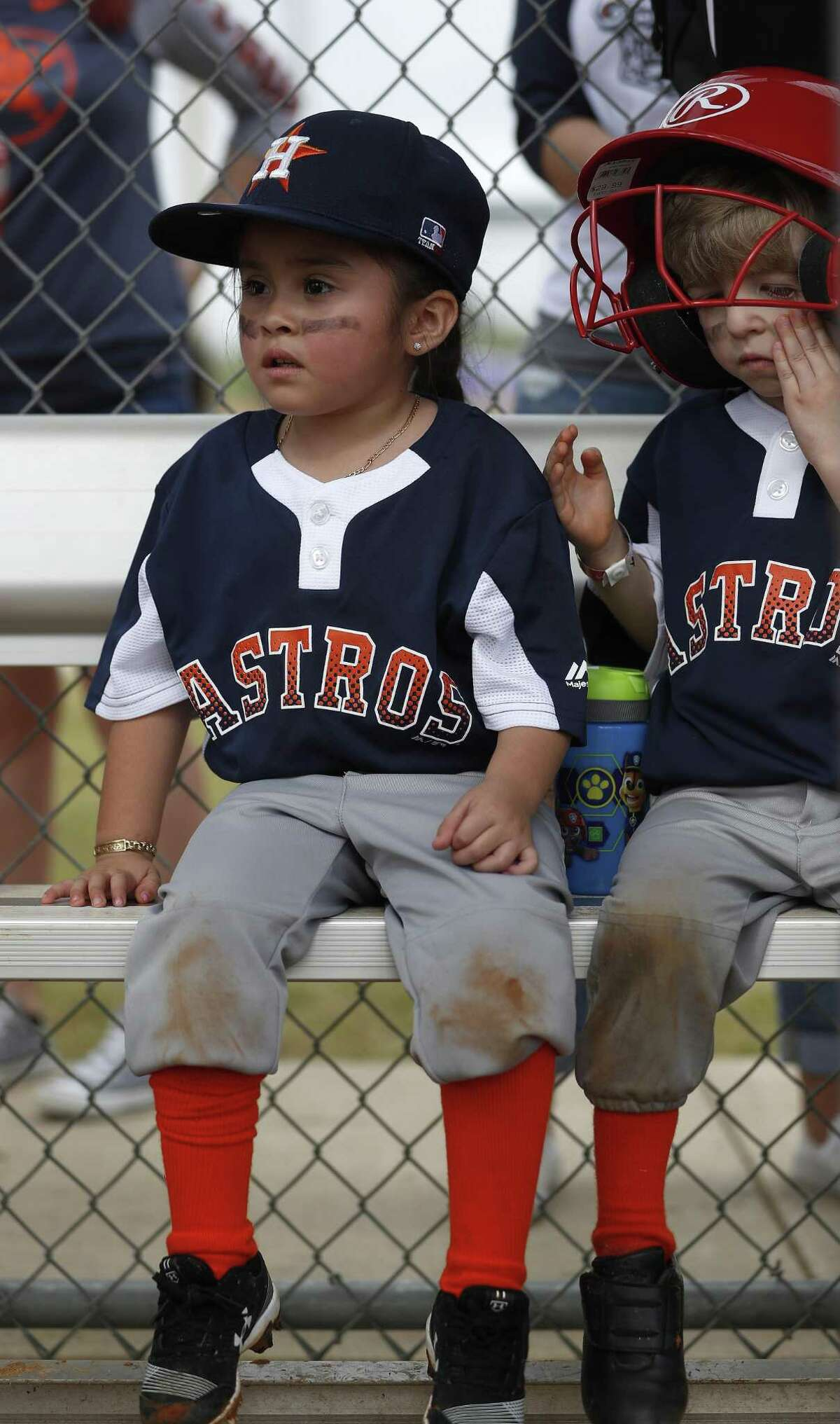 Alayna Montalbo, 4, waits her turn to bat in the dugout during Deer Park PONY baseball games at Spencerview Athletic Complex, Saturday, March 30, 2019, in Deer Park. First the Deer Park PONY baseball league had to cancel games because of bad weather. Then came the ITC chemical fire, which cancelled another full week of games and Opening Day.