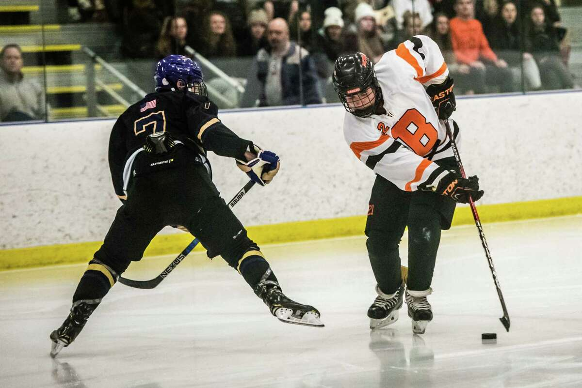 Bethelem's Michael Bievenue manveuvers past Christian Brothers Academy's Mike Cochran as the two teams faced off at the Albany County Hockey Facility in Colonie, NY Friday, December 21st, 2018. Photo by Eric Jenks faced off against Christian Brothers Academy at the Albany County Hockey Facility in Colonie, NY Friday, December 21st, 2018. Photo by Eric Jenks
