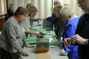 Link Auction Galleries appraisers meet with visitors on Saturday at the Godfrey K of C Hall.