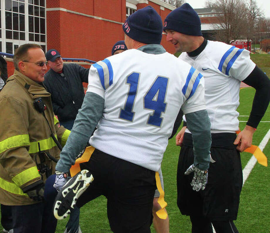 The Jacksonville fire and police departments faced off Saturday in a Guns vs. Hoses flag football game organized by the Illinois College football team. The fire department walked away victorious, defeating the police department 55-24. Photo: Rosalind Essig   Journal-Courier
