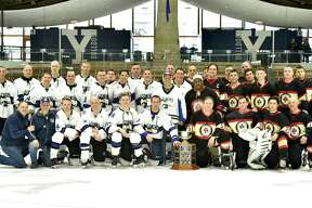 New Haven, Connecticut - Saturday, March 30, 2019: Players of the 23rd annual Chief's Cup charity fundraising hockey game at Yale University's Ingalls Rink in New Haven Saturday afternoon between the New Haven Police Department and the New Haven Fire Department. Honored were Police Officer of the Year Raul Pereira and Firefighter of the Year Michael Miller. The NHPD beneficiary of the event was Officer Tom Murray and the NHFD beneficiary was Clencie Osorio, of Lt. Osorio.