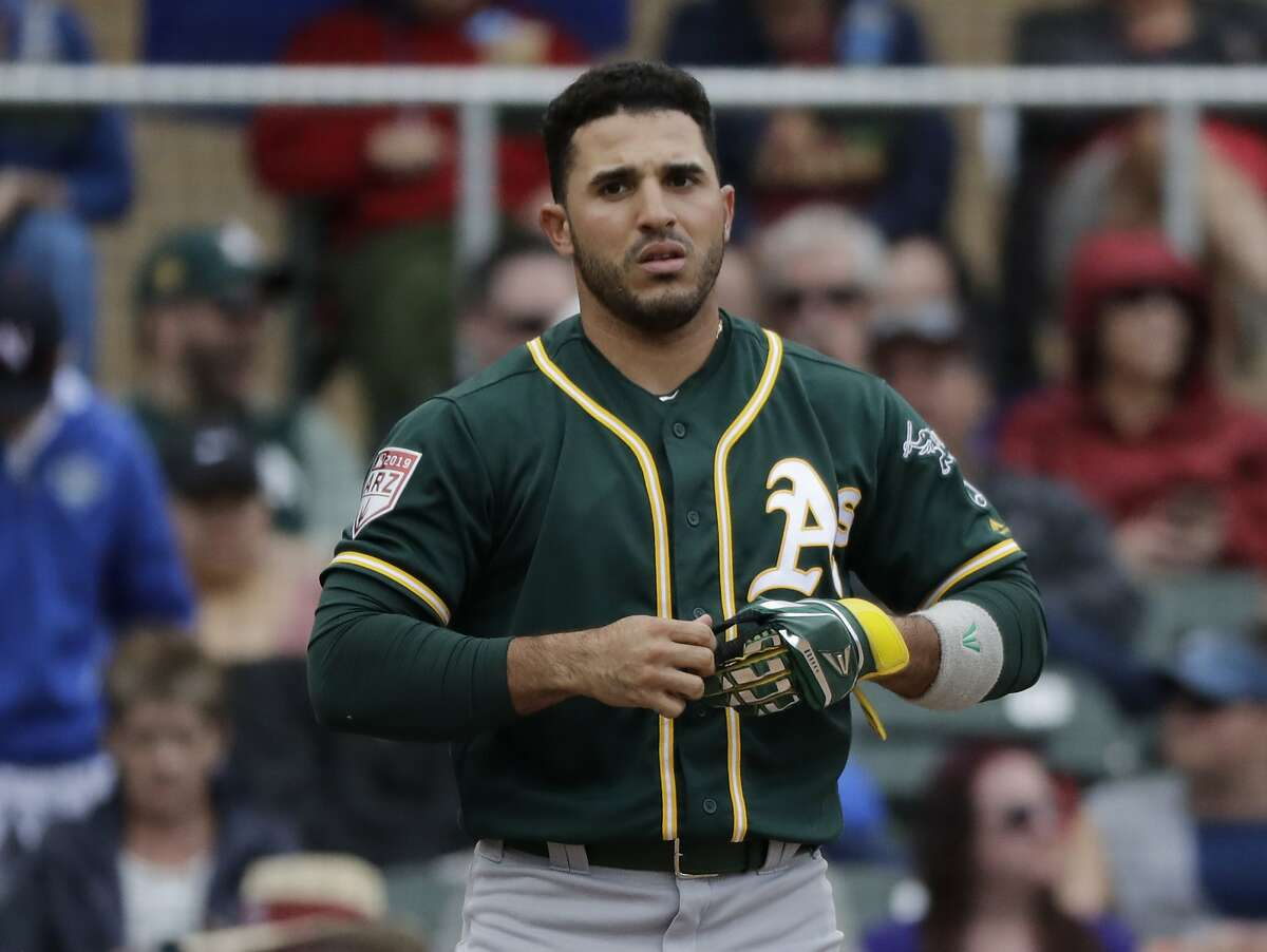 Oakland Athletics' Ramon Laureano walks on the field in a spring training baseball game against the Colorado Rockies Monday, March 11, 2019, in Scottsdale, Ariz. (AP Photo/Elaine Thompson)