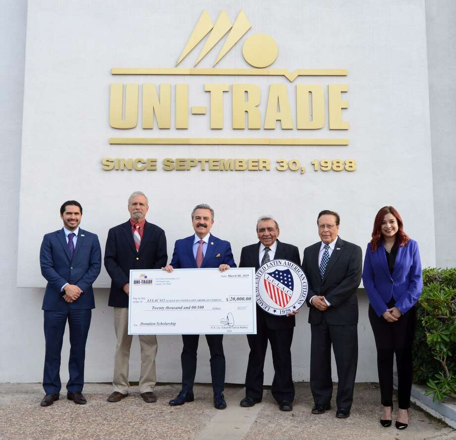 Shown are LULAC Council No. 12 members with a $20,000 donation check from Uni-Trade Forwarding to be used for scholarships. Photo: Couresty Photo