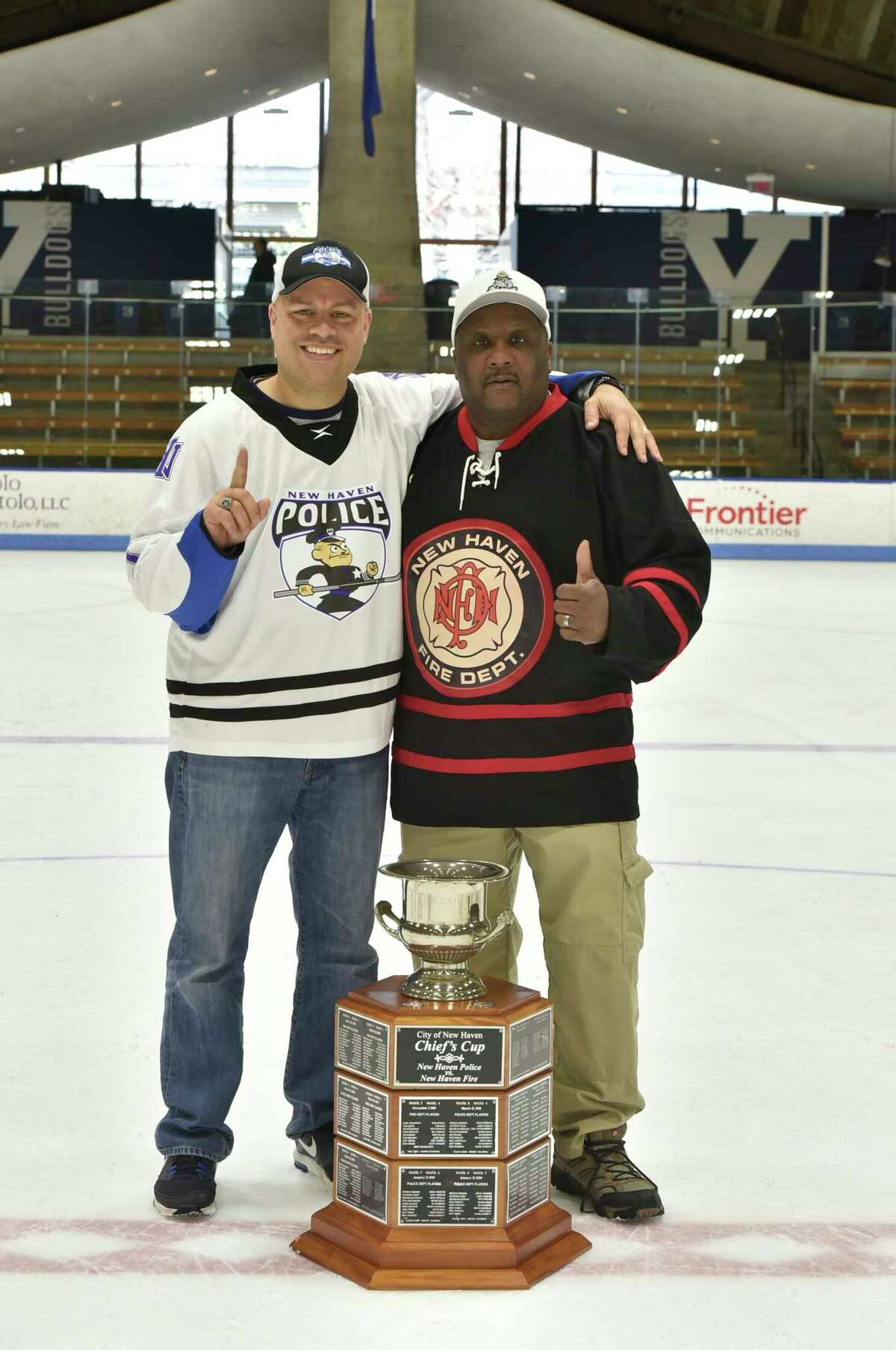 New Haven, Connecticut - Saturday, March 30, 2019: The 23rd annual Chief's Cup charity fundraising hockey game at Yale University's Ingalls Rink in New Haven Saturday afternoon between the New Haven Police Department and the New Haven Fire Department. Honored were Police Officer of the Year Raul Pereira and Firefighter of the Year Michael Miller. The NHPD beneficiary of the event was Officer Tom Murray and the NHFD beneficiary was Clencie Osorio, of Lt. Osorio.
