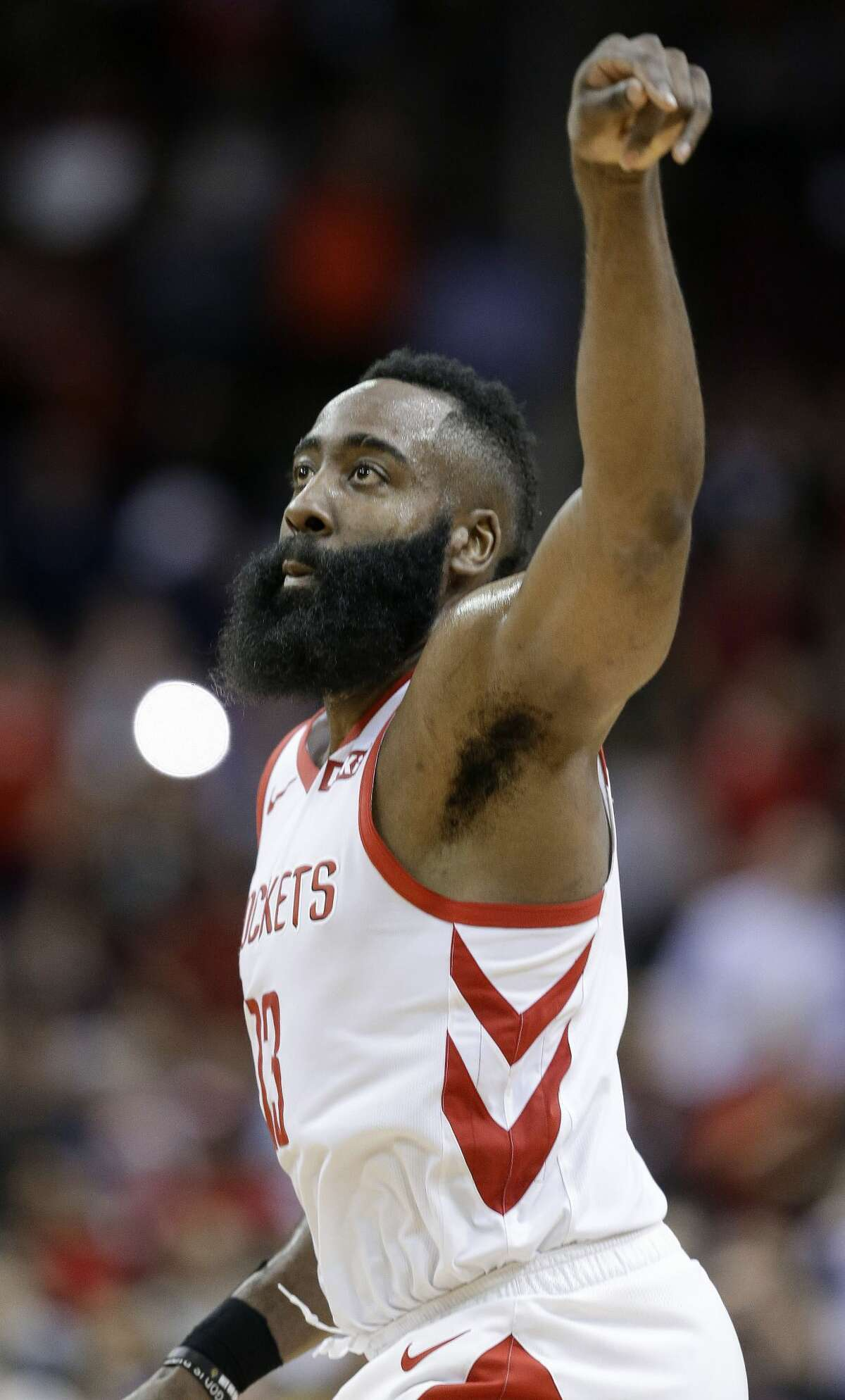 Houston Rockets guard James Harden watches his 3-point basket during the second half of the team's NBA basketball game against the Sacramento Kings, Saturday, March 30, 2019, in Houston. Houston won 119-108. (AP Photo/Eric Christian Smith)