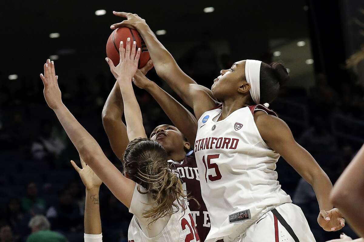 Stanford's Maya Dodson (15) blocks a shot boy Missouri State's Brice Calip during the second half of a regional semifinal game in the NCAA women's college basketball tournament, Saturday, March 30, 2019, in Chicago. (AP Photo/Nam Y. Huh)