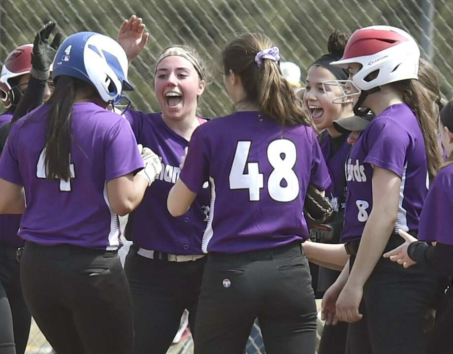 North Branford softball players congratulate teammate Katy Pedersen after crossing the plate during the third inning against East Haven on Saturday. Photo: Peter Hvizdak / Hearst Connecticut Media / New Haven Register