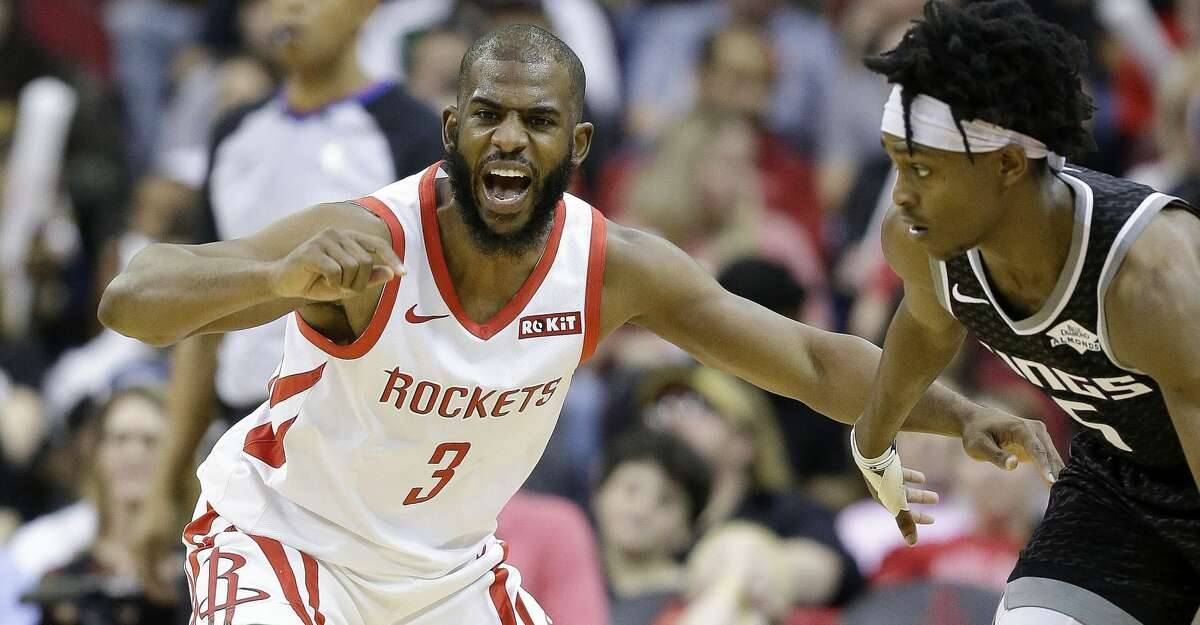 Houston Rockets guard Chris Paul (30 yells instructions while defending Sacramento Kings guard De'Aaron Fox during the second half of an NBA basketball game, Saturday, March 30, 2019, in Houston. Houston won the game, 119-108. (AP Photo/Eric Christian Smith)