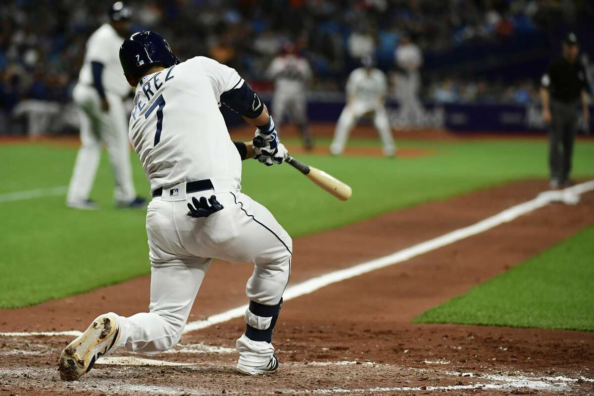 ST PETERSBURG, FLORIDA - MARCH 30: Michael Perez #7 of the Tampa Bay Rays hits an RBI single in the fifth inning against the Houston Astros at Tropicana Field on March 30, 2019 in St Petersburg, Florida. The Rays won 3-1. (Photo by Julio Aguilar/Getty Images)