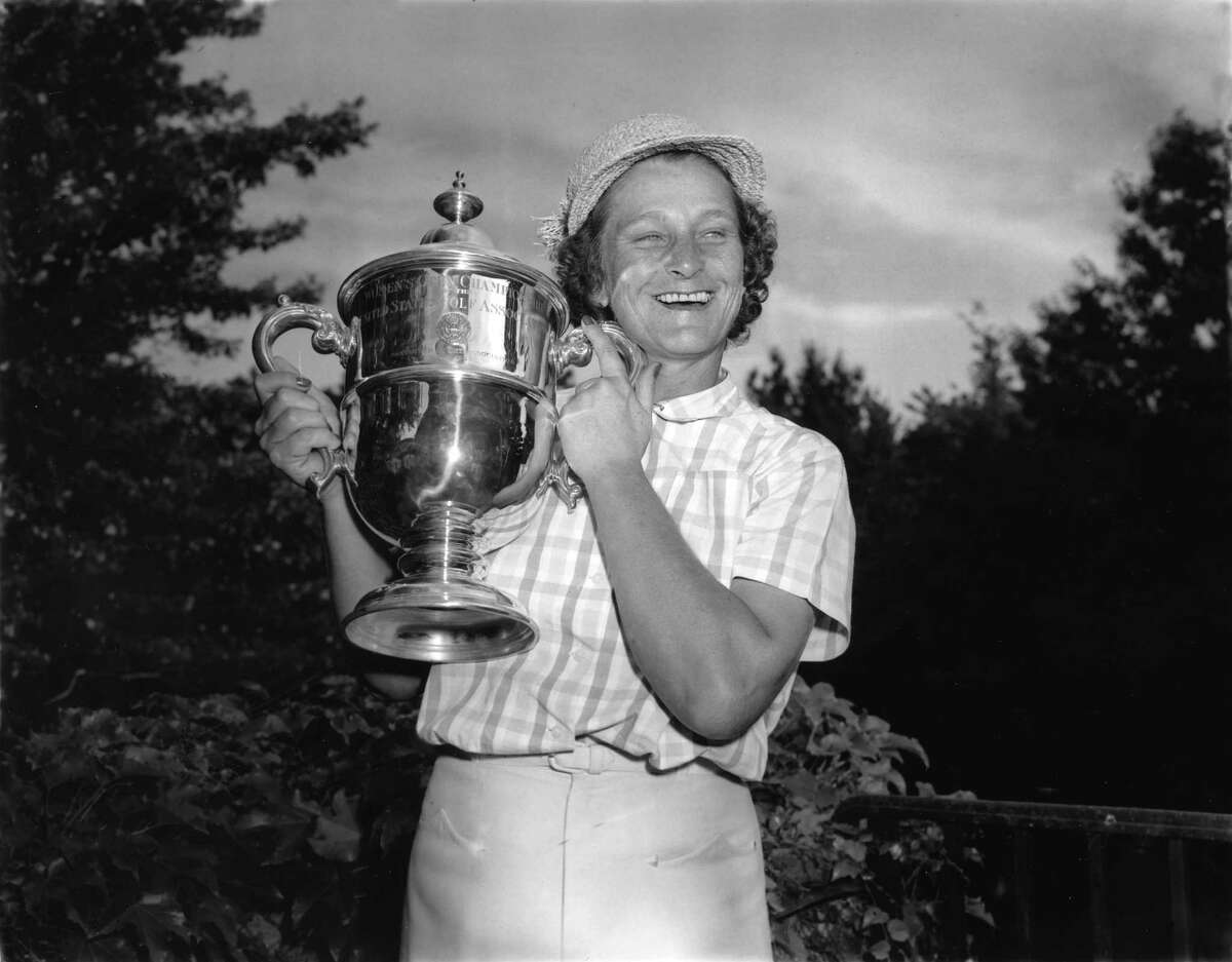 ** ADVANCE FOR WEEKEND EDITIONS MAY 17 18 * Babe Didrikson Zaharias smiles as she holds her Women's U.S. Open Golf Championship trophy cup at Salem Country Club in Peabody, Ma., July 3, 1954. Zaharias' name has come up often lately because she's the last woman to tee it up with men at a PGA event, doing so in the 1945 Los Angeles Open. She got in by qualifying, made the 36-hole cut and was eliminated the next day with a 79. (AP Photo)