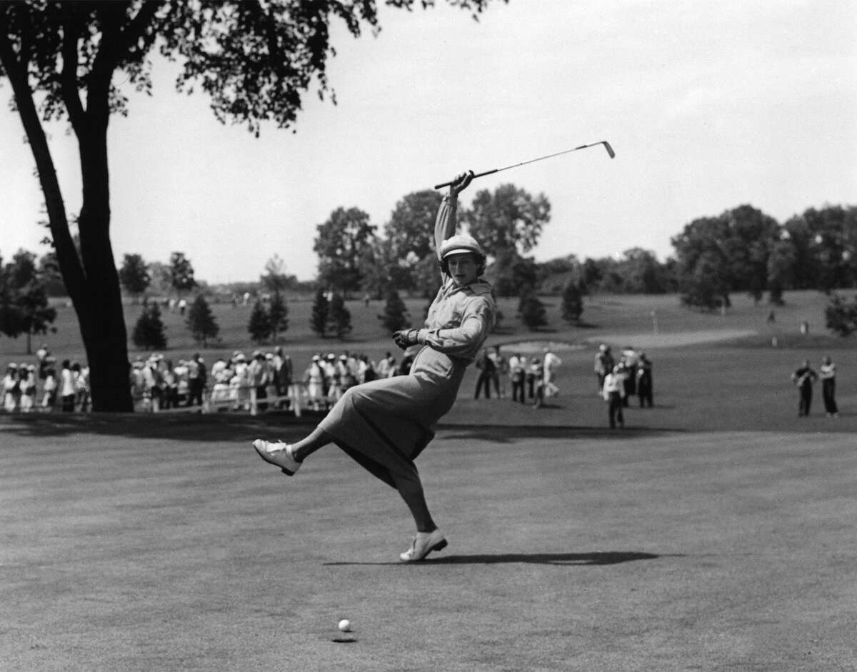 ** ADVANCE FOR WEEKEND EDITIONS MAY 17 18 ** Babe Didrikson Zaharias urges the ball into the cup on the 18th green of Chicago's Tam O'Shanter Country Club in the women's All-American Golf Tournament Aug. 4, 1950. Zaharias' name has come up often lately because she's the last woman to tee it up with men at a PGA event, doing so in the 1945 Los Angeles Open. She got in by qualifying, made the 36-hole cut and was eliminated the next day with a 79. (AP Photo/Ed Maloney)