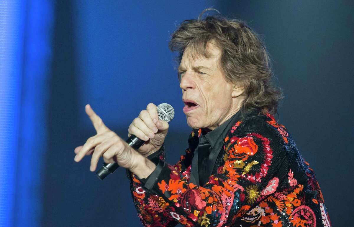 FILE - In this Oct. 22, 2017 file photo, Mick Jagger of the Rolling Stones performs during the concert of their 'No Filter' Europe Tour 2017 at U Arena in Nanterre, outside Paris, France. The Rolling Stones are postponing their latest tour so Jagger can receive medical treatment. The band announced Saturday, March 30, 2019 that Jagger ?has been advised by doctors that he cannot go on tour at this time.? The band added that Jagger ?is expected to make a complete recovery so that he can get back on stage as soon as possible.? (AP Photo/Michel Euler, File)