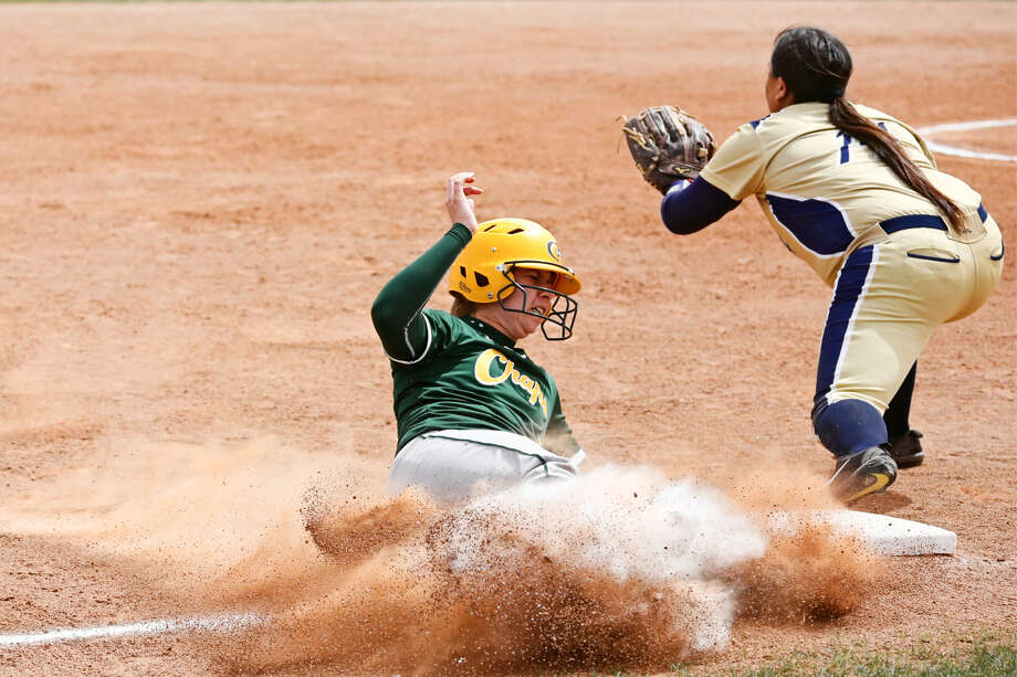 Lady Chap Rocio Barajas slides safely into third base in action versus FPC, Saturday at MC softball field. Photo: Midland College Athletics
