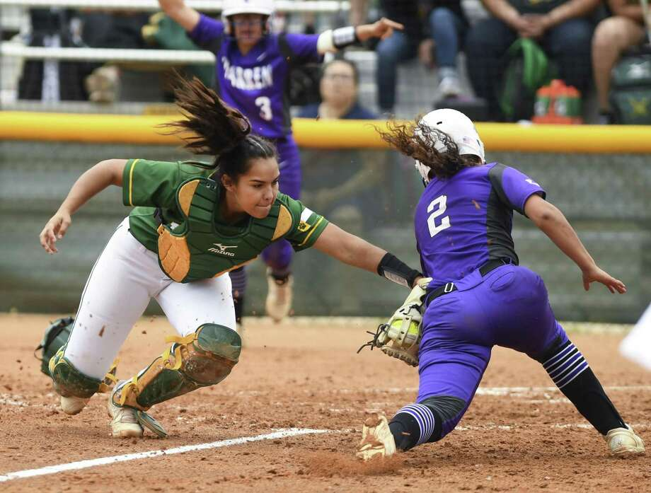 Holmes catcher Erykah Guerrero tags out Dynasty Harpel of Warren during District 28-6A softball action at the Northside ISD Sports Complex on Saturday, March 30, 2019. Warren won the game, 3-0. Photo: Billy Calzada / Staff Photographer / San Antonio Express-News
