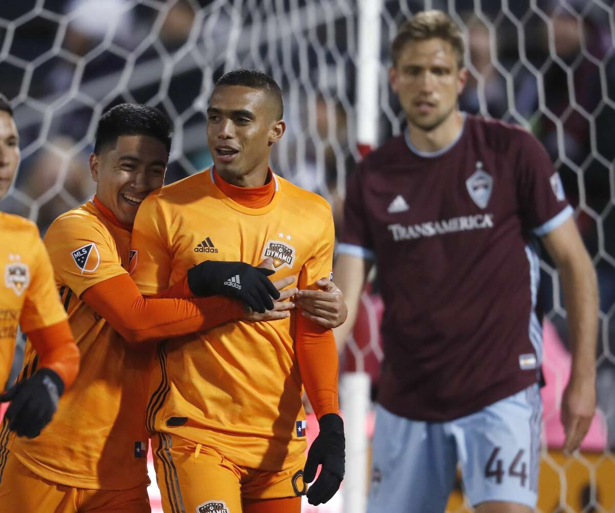 Houston Dynamo midfielder Memo Rodriguez, left, hugs forward Mauro Manotas after his goal against the Colorado Rapids in the first half of a MLS soccer match Saturday, March 30, 2019, in Commerce City, Colo. (AP Photo/David Zalubowski)