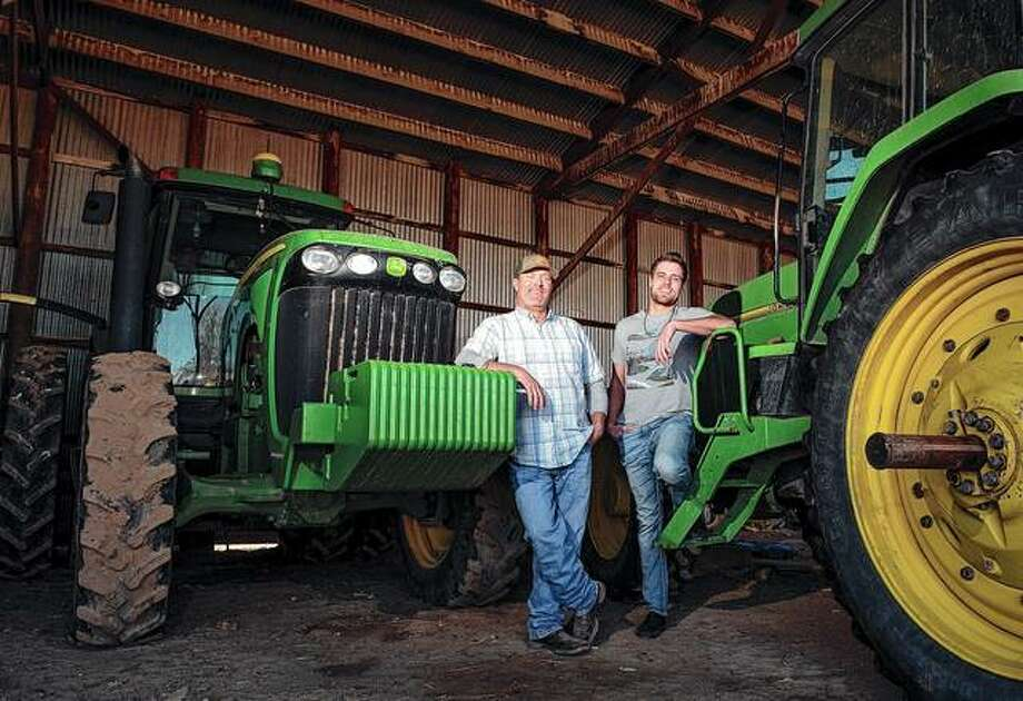 Grant Cummins and his son Parker farm mint. Extracting oil from the peppermint crop is only part of Cummins' business. Photo: Drew Nash | The Times-News (AP)