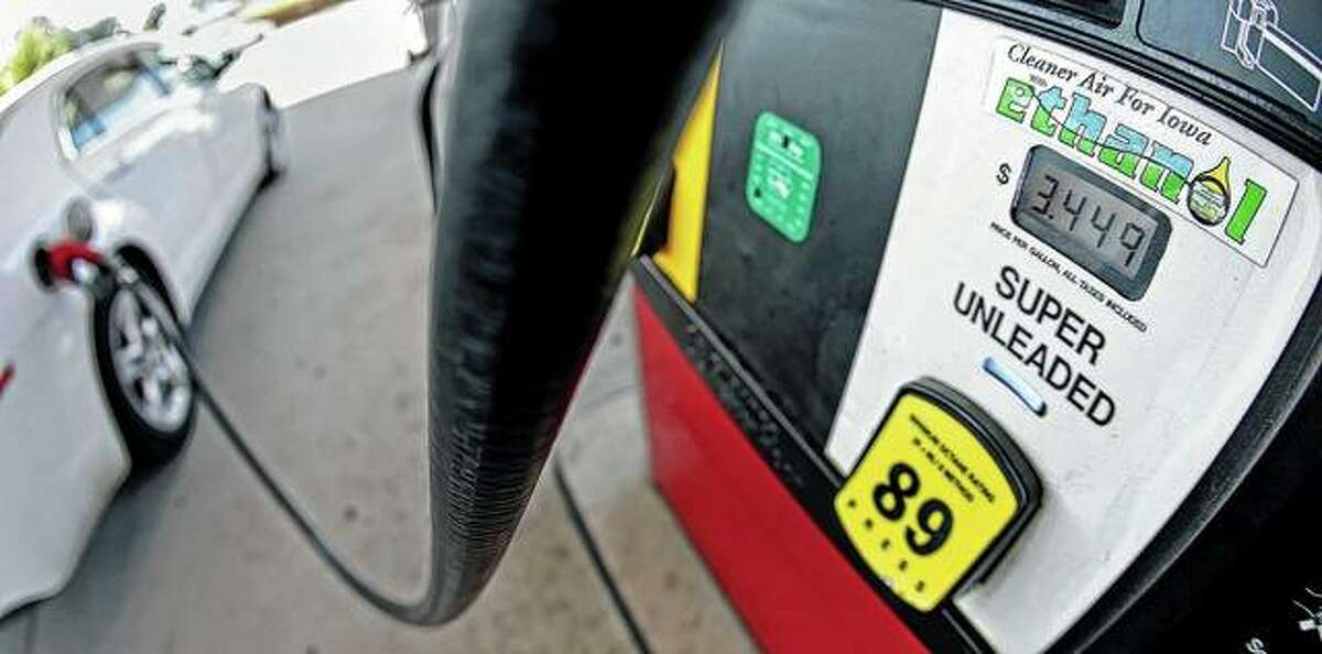 A motorist fills up with gasoline. NEXT: See gasoline prices in Texas' biggest cities.