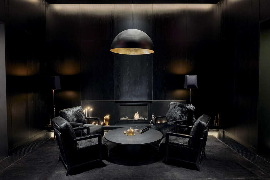 A fireside lounge space on the lobby floor of Times Square Edition. The hotel includes a handful of ambitious restaurants by John Fraser, a black-and-white-on-white color scheme, and Blade Runner-style terraces that make Times Square look tiny. Photo: Bloomberg Photo By Zack DeZon / Bloomberg
