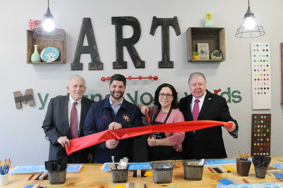 My Signs Your Words on held a grand opening at 109 College St., Middletown, Feb. 26. From left are Middlesex County Chamber of Commerce President Larry McHugh, Mayor Dan Drew, owner Tara Sitilides and Chamber Chairman Jay Polke. Photo: Contributed Photo