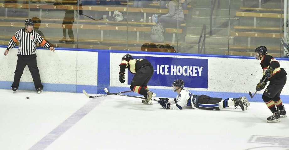 New Haven, Connecticut - Saturday, March 30, 2019: The 23rd annual Chief's Cup charity fundraising hockey game at Yale University's Ingalls Rink in New Haven Saturday afternoon between the New Haven Police Department and the New Haven Fire Department. Honored were Police Officer of the Year Raul Pereira and Firefighter of the Year Michael Miller. The NHPD beneficiary of the event was Officer Tom Murray and the NHFD beneficiary was Clencie Osorio, of Lt. Osorio. Photo: Peter Hvizdak / Hearst Connecticut Media / New Haven Register