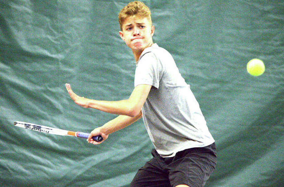 Edwardsville sophomore Ben Blake makes a forehand return during his No. 5 singles match against Normal University High Saturday at the Edwardsville Meyer Center YMCA. Photo: Scott Marion/Intelligencer