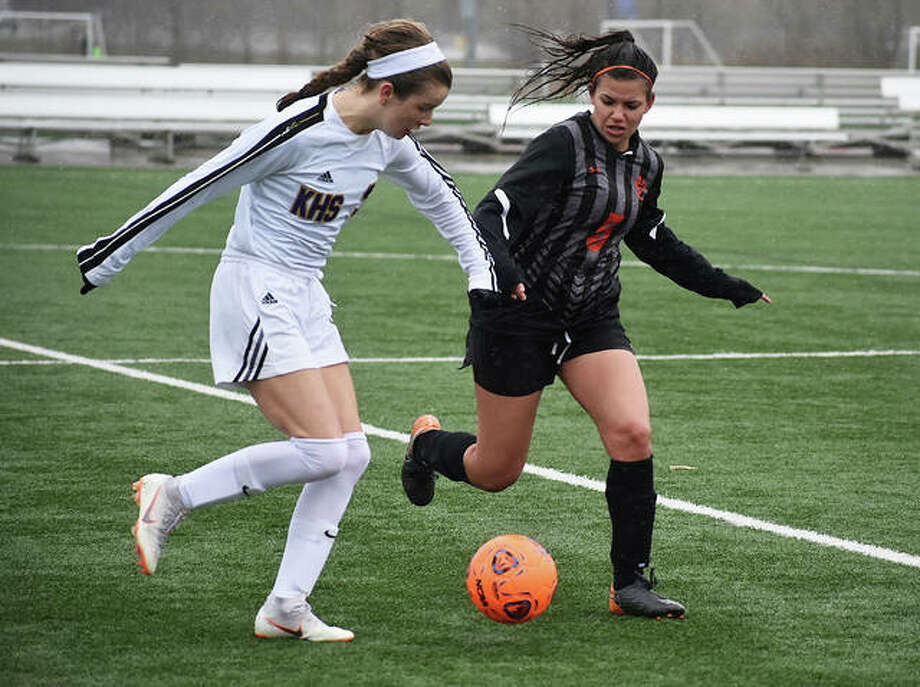 Playing in wet, cold conditions, the Edwardsville girls' soccer team lost 2-1 in the final game of the Parkway Showcase. Edwardsville went 0-2 in the event, also losing 2-1 to Fort Zumwalt South on Friday. On Saturday, EHS fell behind 2-0 less than 15 minutes into the first half on a pair of goals by Caroline Kelly. The Tigers cut the lead to 2-1 on a goal by Delaney Kuhns, but couldn't complete the rally. Now 5-6 on the season, Edwardsville will host Belleville West at 6:45 p.m. Tuesday inside the District 7 Sports Complex. Pictured above is Ava Walls, right, playing defense for the Tigers. Photo: Matt Kamp/The Intelligencer