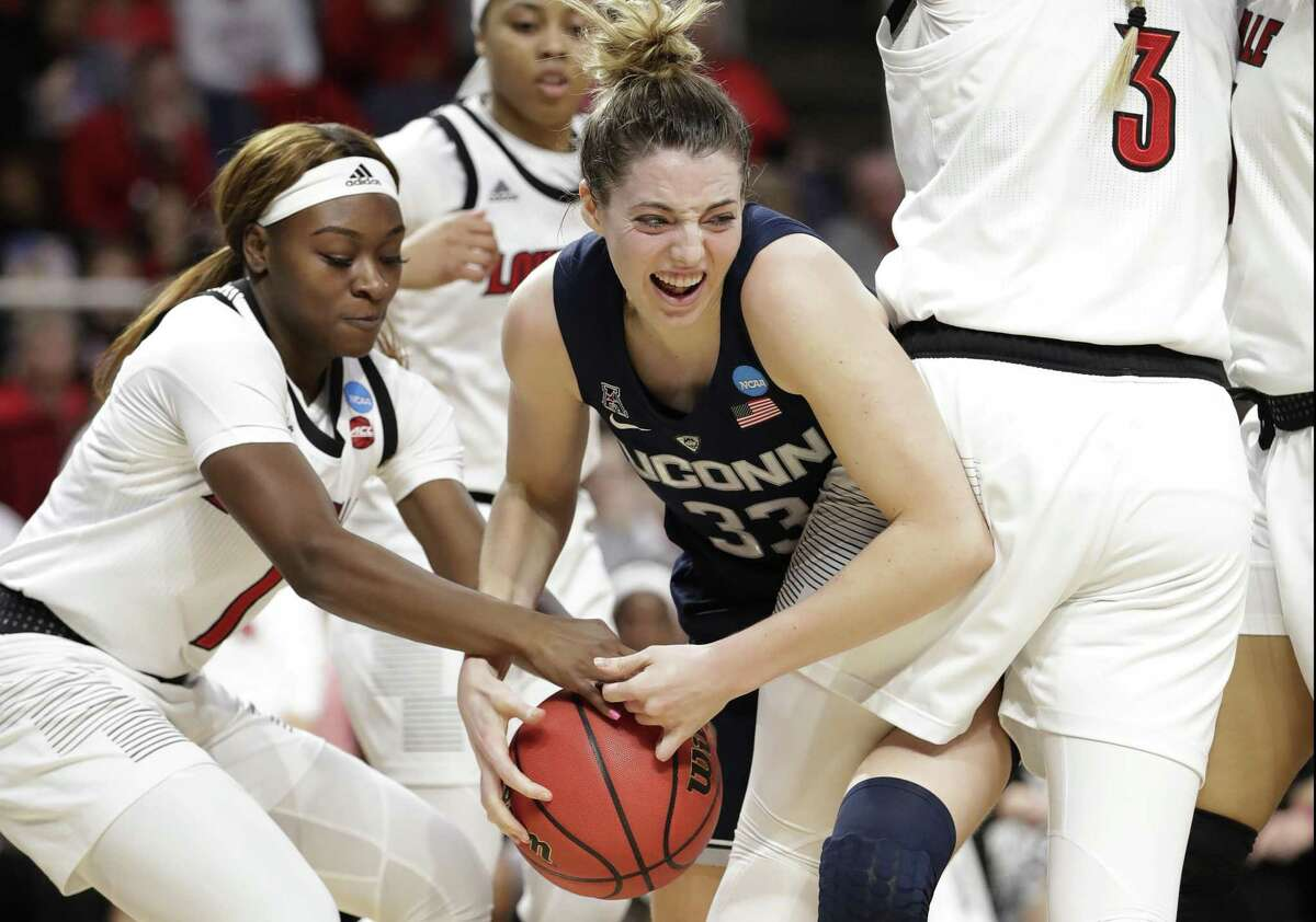 Louisville guard Dana Evans tries to strip the ball from UConn guard Katie Lou Samuelson during the first half of a regional championship final in the NCAA women's college basketball tournament Sunday in Albany, N.Y.