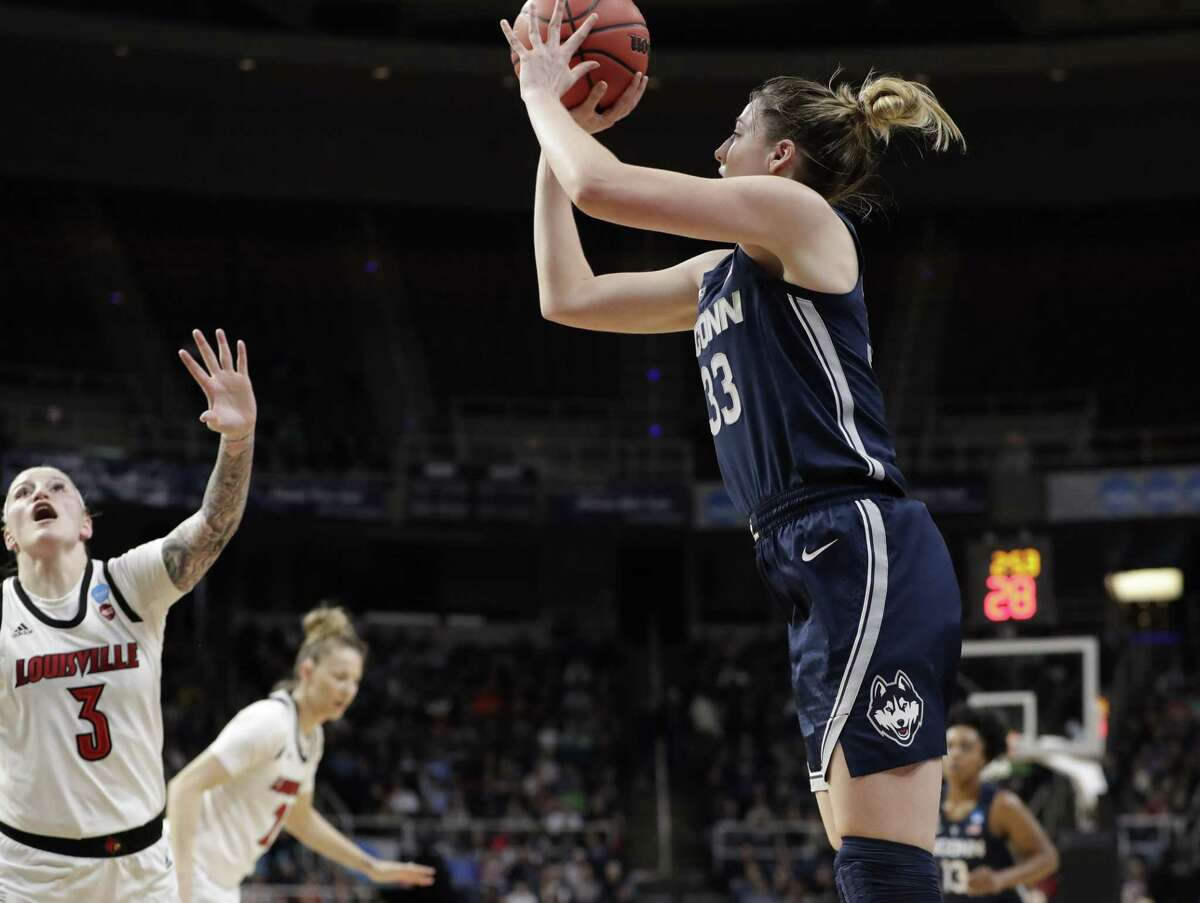 Louisville forward Sam Fuehring (3) defends as UConn guard Katie Lou Samuelson shoots from the perimeter during the first half of a regional championship final in the NCAA women's college basketball tournament Sunday in Albany, N.Y.