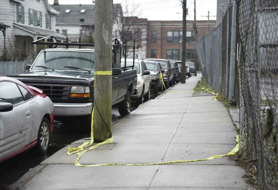 Police tape marks the scene of a fatal shooting on Garden Street in the South End of Stamford on Sunday. Photo: Tyler Sizemore / Hearst Connecticut Media / Greenwich Time