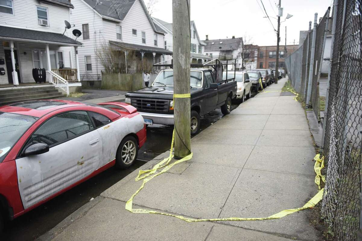 Police tape marks the scene of a fatal shooting on Garden Street in the South End of Stamford, Conn. Sunday, March 31, 2019. A man in his mid-20s was shot multiple times and killed late Saturday night. The shooting is city's first homicide of 2019 and nobody has yet been arrested in connection with the crime.