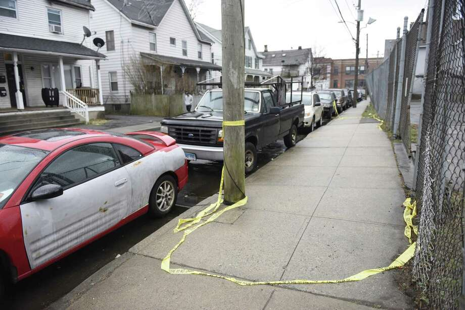 Police tape marks the scene of a fatal shooting on Garden Street in the South End of Stamford, Conn. Sunday, March 31, 2019. A man in his mid-20s was shot multiple times and killed late Saturday night. The shooting is city's first homicide of 2019 and nobody has yet been arrested in connection with the crime. Photo: Tyler Sizemore / Hearst Connecticut Media / Greenwich Time