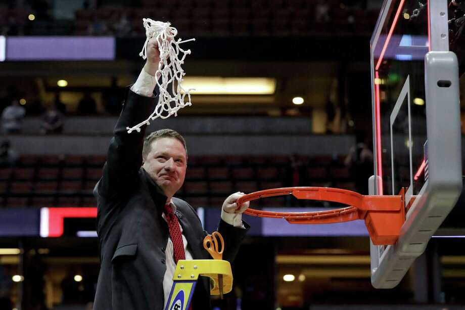 Texas Tech coach Chris Beard holds up the net after the team's win over Gonzaga in the West Regional final in the NCAA men's college basketball tournament Saturday, March 30, 2019, in Anaheim, Calif. Photo: Marcio Jose Sanchez, STF / Associated Press / Copyright 2019 The Associated Press. All rights reserved