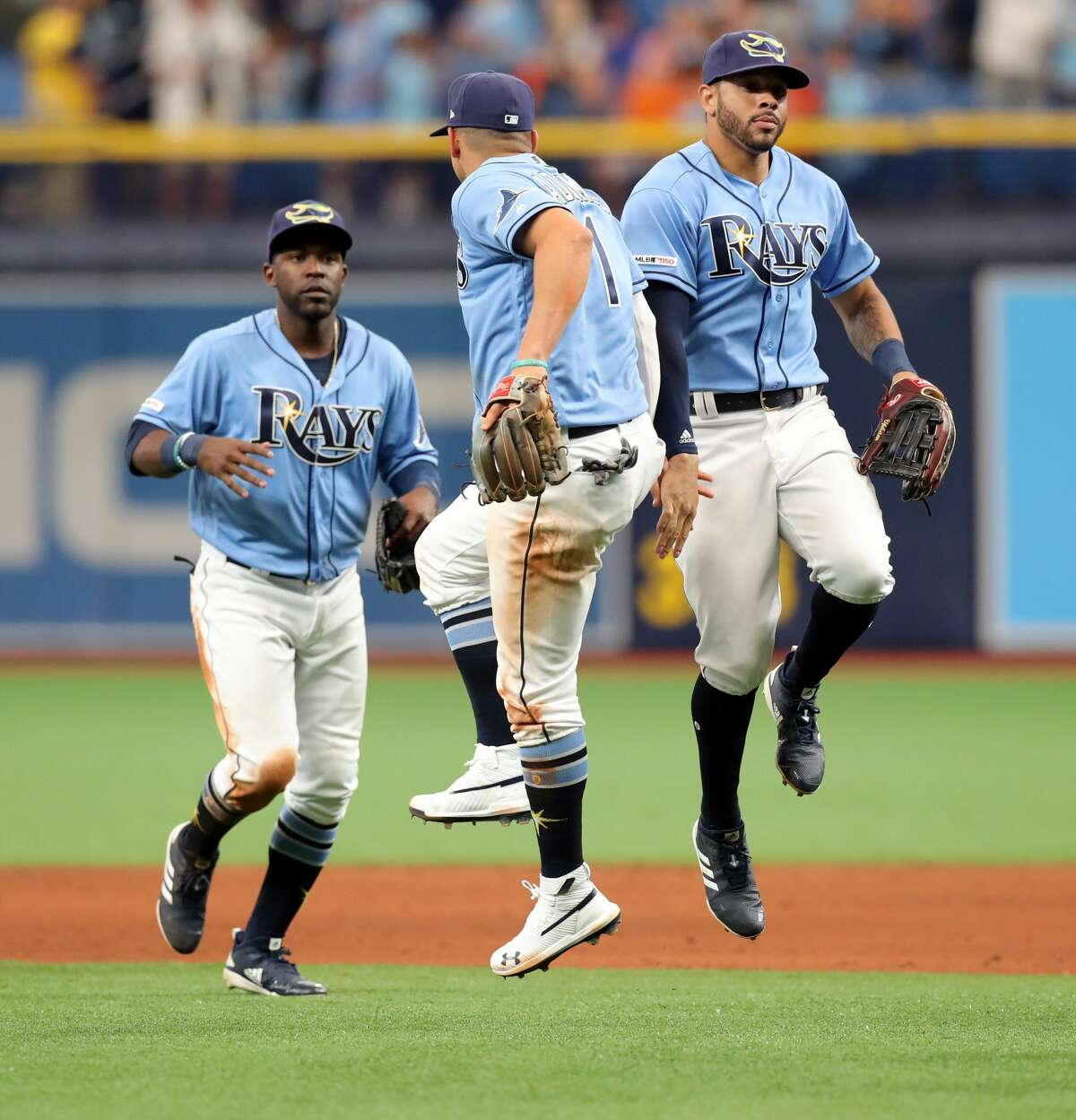 ST. PETERSBURG, FL - MARCH 31: Tommy Pham #29 of the Tampa Bay Rays, right, celebrates with Willy Adames #1 after a win over the Houston Astros in a baseball game at Tropicana Field on March 31, 2019 in St. Petersburg, Florida. (Photo by Mike Carlson/Getty Images)